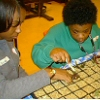 caregiver and child working on a project