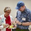 Master Gardener volunteers examining a plant sample