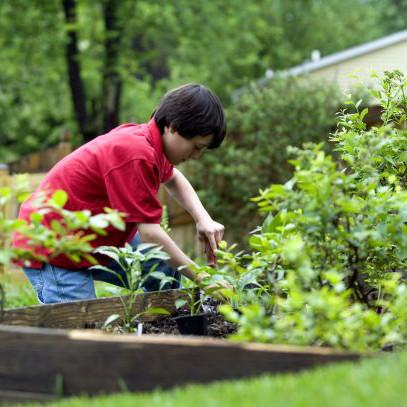 cute-young-boy-gardening-in-his-home-backyard-1