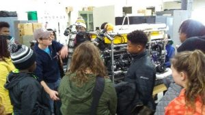 A UW Milwaukee student teaches Tech Wizards about Underwater Remote Operating Vehicles