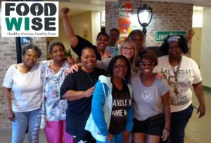 A FoodWIse StrongBodies class celebrates at the end of a fitness session.