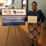 Lilliann Paine posing with her award from the Wisconsin Public Health Association